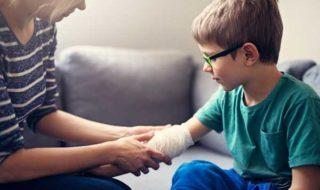 mom bandages child's arm