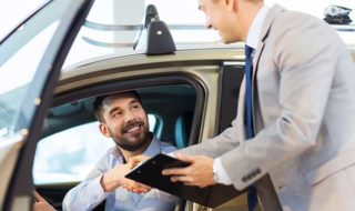 Service advisor assists driver