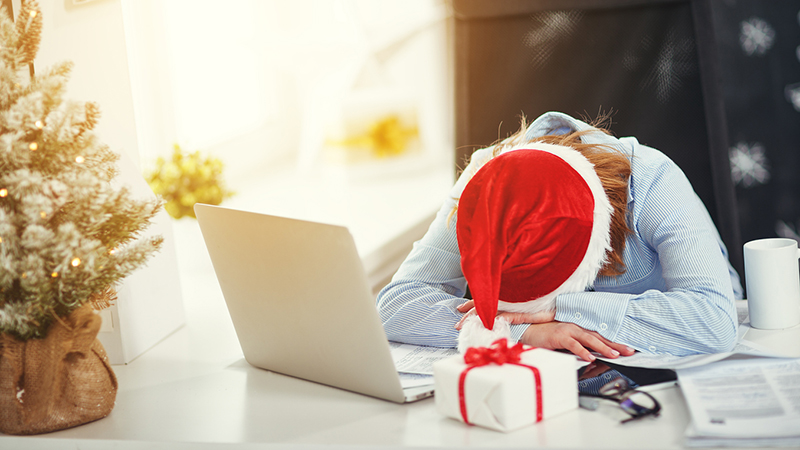 woman at work in Santa hat