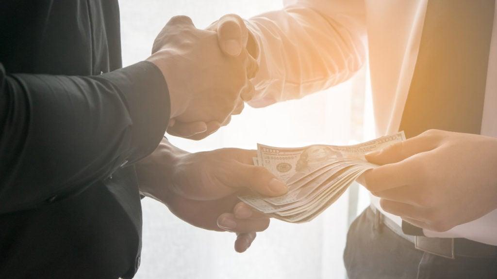 professionals exchange money